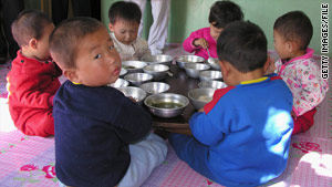 Many North Korean children, like these shown with World Food Programme provisions in 2005, battle malnutrition.