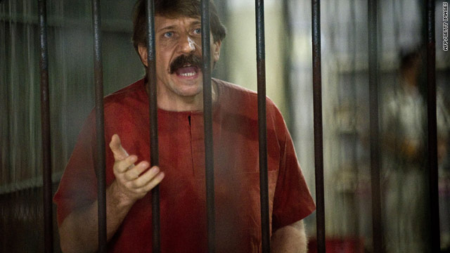 Alleged arms dealer Viktor Bout talks to the media in a temporary cell ahead of his court hearing in Bangkok.
