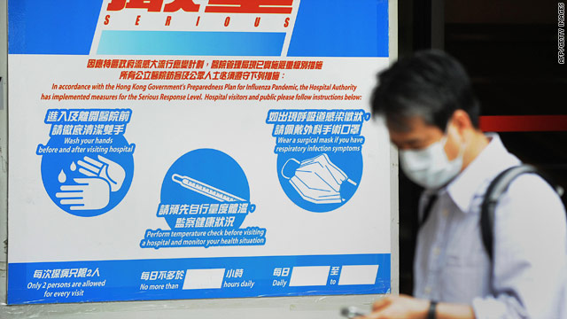 Precautionary signs permanently posted at a hospital in Hong Kong, a city at the forefront of 2003 SARS epidemic.