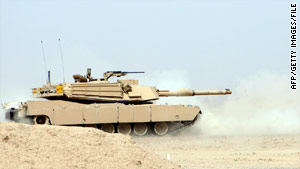 Iraqi troops use a M1A1 Abrams tank during a March training session. The U.S. is bringing the tanks to Afghanistan.