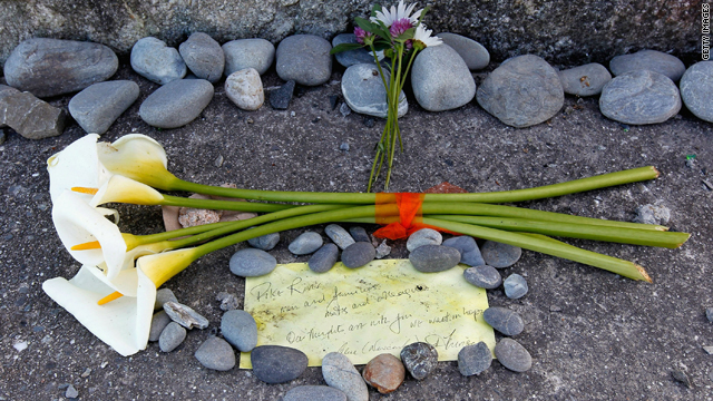 Flowers and a note lay at the foot of the Strongman Mine Memorial on Monday in Greymouth, New Zealand.