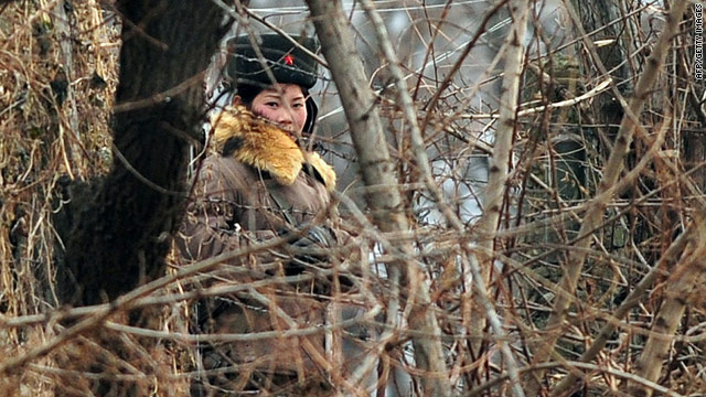 An armed North Korean soldier on border patrol near the Yalu River in the North Korean town of Siniuju on November 24, 2010.
