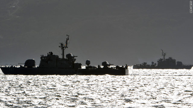 South Korean navy vessels patrol on Thursday near Yeonpyeong island, close to waters disputed by both countries.