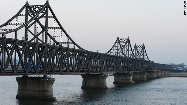 A truck crosses the Sino-Korean Friendship Bridge which links the N. Korean town of Siniuju to Dandong (L) in northeast China.