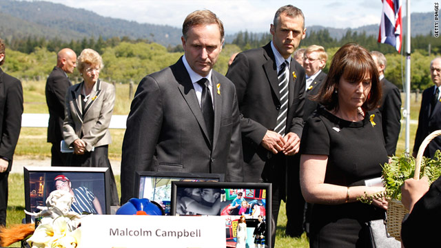 PM John Key and wife Bronagh pay respects at a memorial service for the 29 miners at Omoto Racecourse on Thursday.