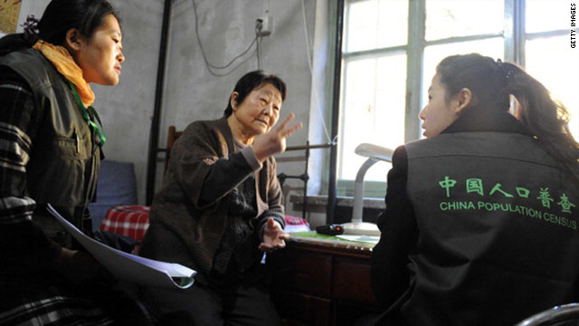 Census workers gather data from an elderly woman at her home in Beijing on November 1.