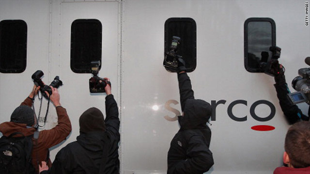 Photographers try to get a shot of Julian Assange, believed to be in this prison van at Westminster Magistrates Court, Dec. 7.