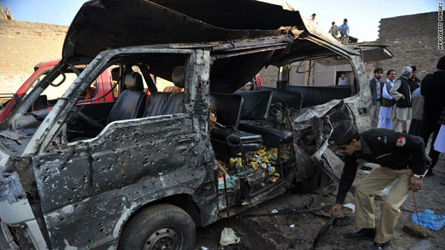 A police officer inspects a van after a suicide bomb attack in Kohat, Pakistan on December 8, 2010.