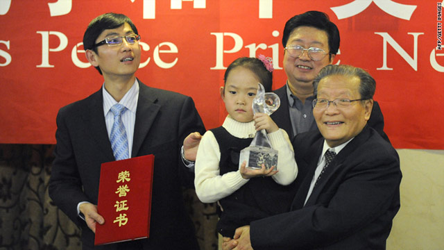 Zeng Yuhan holds the Confucius Peace Prize trophy awarded to Lien Chan, Taiwan's former vice president, December 9, 2010.