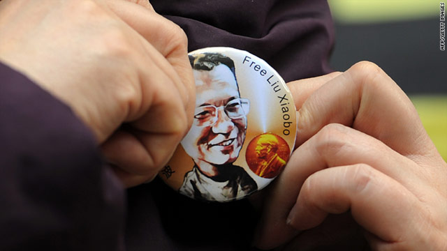 A woman wears a badge calling for the release of Liu Xiaobo outside the legislative council in Hong Kong on December 8, 2010.