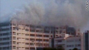 The fire started on the 10th floor of a 12-story building in an industrial area just outside the capital city, Dhaka.
