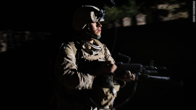 A U.S. Marine conducts night patrol in March in Helmand province, Afghanistan.