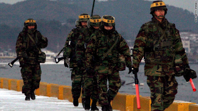 South Korean marines patrol along the wharf on Yeonpyeong island near the maritime border between the two Koreas.
