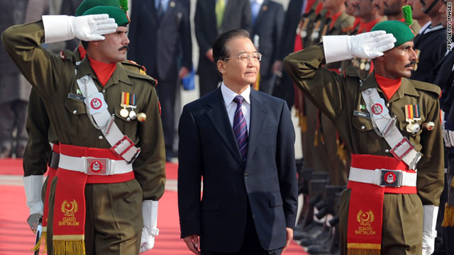 Chinese Prime Minister Wen Jiabao inspects a guard of honor during a welcoming ceremony in Pakistan.