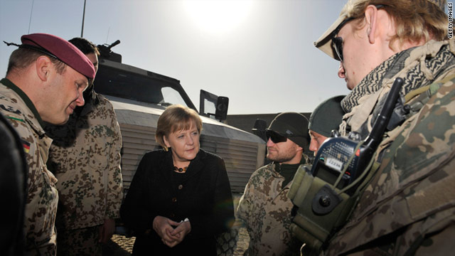 German Chancellor Angela Merkel stops to visit troops Saturday in Kunduz in northern Afghanistan.