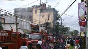 Rescue services arrive at the buring hotel in Tuguegarao City, north of Manila, on Sunday, December 19.