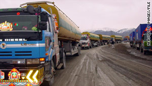 NATO trucks driven by Pakistani drivers prepare to cross into Afghanistan in 2009.