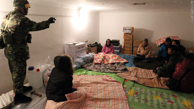 A South Korean soldier talks to residents gathered in a bunker ahead of the live-fire drill on Yeonpyeong island.
