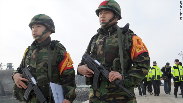South Korean marine military police patrol on the island of Yeonpyeong following the live fire drills.