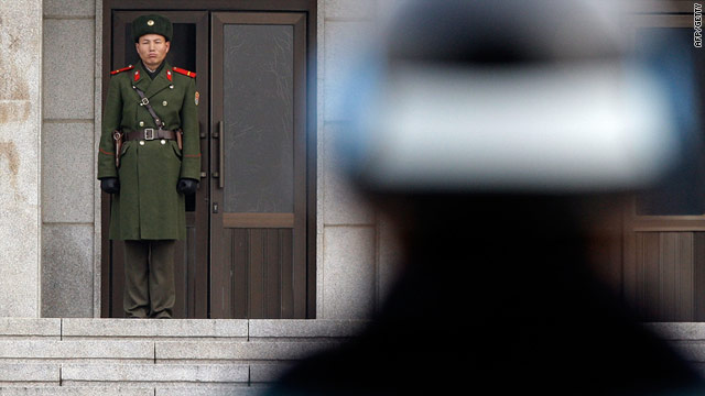 A North Korean soldier looks at a South Korean soldier at the demilitarized zone of Panmunjom, South Korea on December 8.