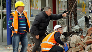 Structural inspectors survey an earthquake-damaged  building in Christchurch, New Zealand, on September 5.