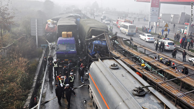 Police block off a road after dozens of vehicles crashed in Zunyi, China, on Monday.