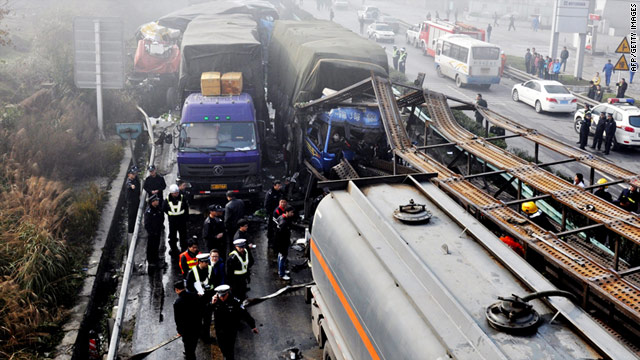 Chinese police block off area after a pile-up involving more than 100 vehicles in southwest Guizhou province on Monday.