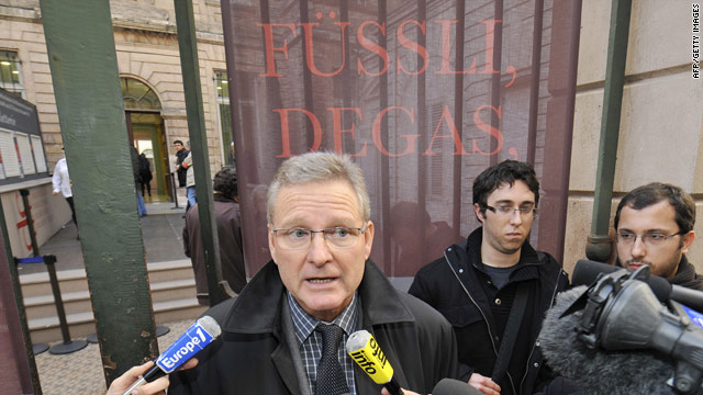 Marseille deputy mayor Daniel Hermann speaks to journalists in front of the entrance of Cantini Museum in Marseille.