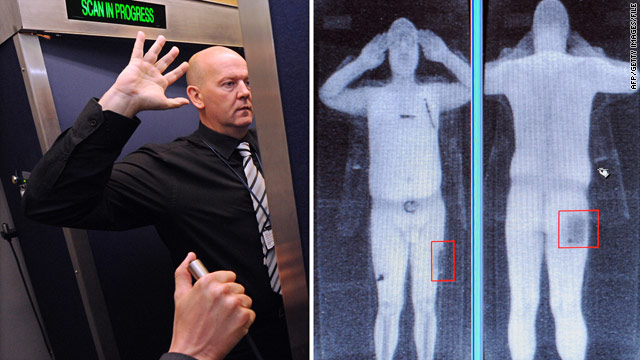 An airport employee demonstrates body scan technology in Manchester, England, in October.