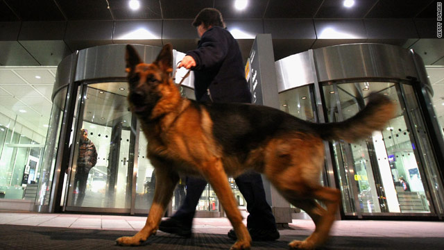 A security officer patrols with a sniffer dog at Munich Airport's Terminal 2 on Wednesday.
