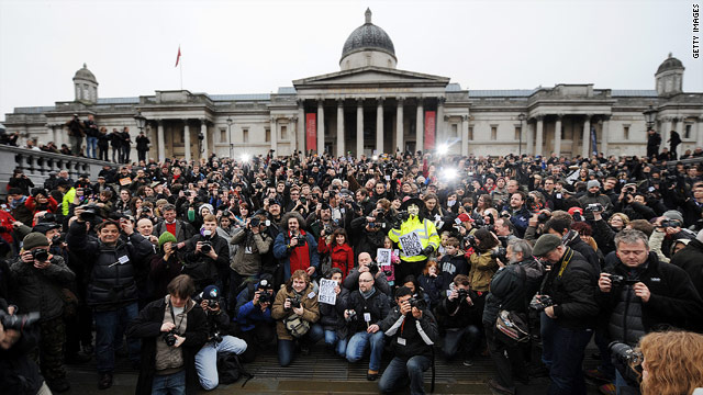 Photographers assembled in London's Trafalgar Square to protest terrorism laws in the UK on Saturday.