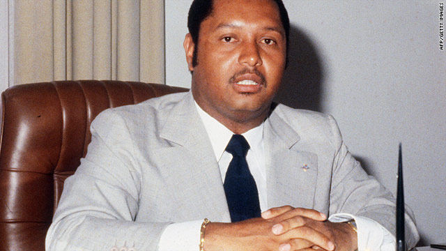 A photo dated March 1982 shows Haiti 's former president Jean-Claude Duvalier sitting in his office at the presidential palace.