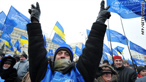 Supporters of Viktor Yanukovich celebrate in front of the Central Election Commission in Kiev.