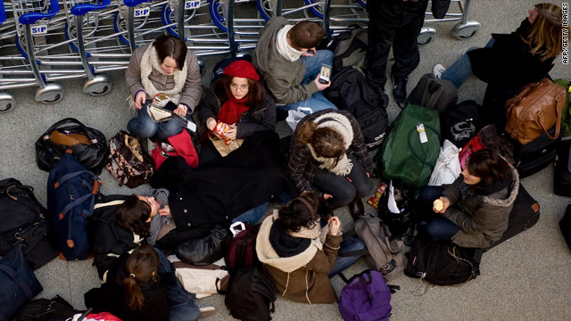 Eurostar passengers wait at the Eurostar terminal in London, December 2009, after weather disrupted services.