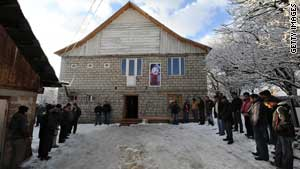 Friends and relatives of Nodar Kumaritashvili pay respects outside his house Saturday during his wake