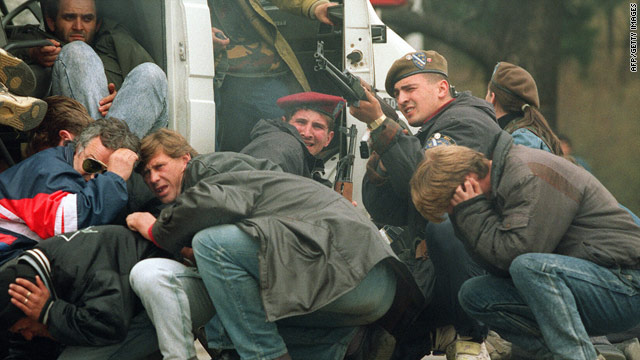 A special forces soldier returns fire in April 1992 in Sarajevo as he and civilians come under fire from Serbian snipers.