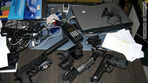 Italian police photos show some of the weapons and equipment seized in the operation.
