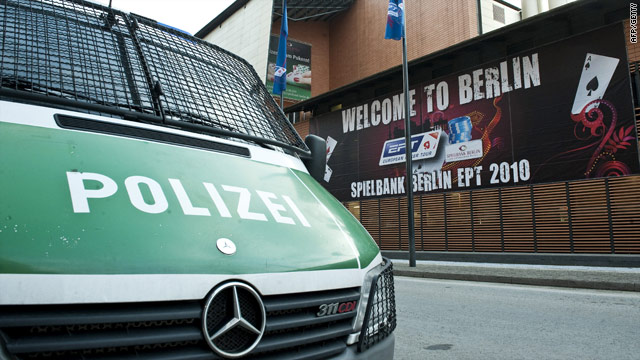 A police vehicle parked in front of the Grand Hyatt Hotel, Berlin, scene of the raid on an international poker tournament.