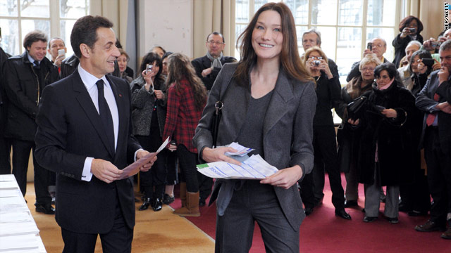 French President Nicolas Sarkozy and First Lady Carla Bruni-Sarkozy cast their votes Sunday at a Paris polling station.