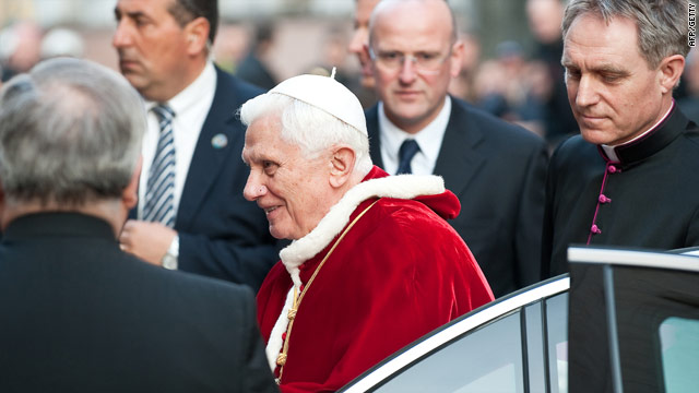 Pope Benedict XVI arrives at the Lutheran church in Rome Monday as a deepening sex abuse scandal engulfs the Vatican.