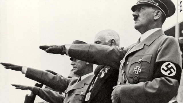 Attempts at appeasement: Adolf Hitler salutes teams during the opening ceremonies of the Olympic Games in Berlin, 1936.
