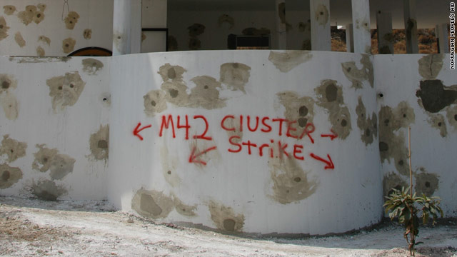 FILE: Words of warning at a house in Lebanon where unexploded submunitions from cluster munitions were found scattered.