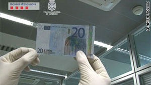 Spanish police image shoes counterfeit 20-euro banknote.