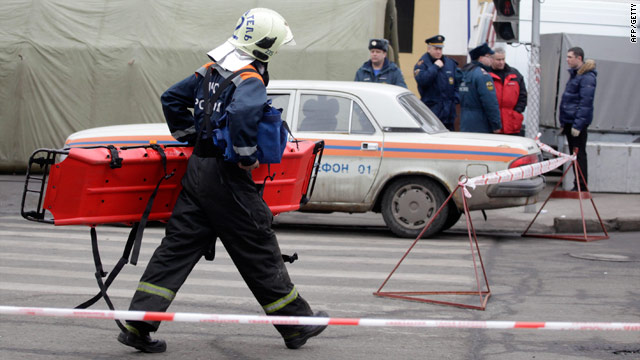 A Russian emergency worker carries a stretcher to the Park Kulturi metro station in Moscow Monday after a suicide attack.