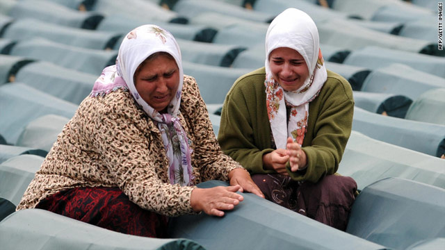 Bosnian Muslim women weep among coffins displayed at the memorial center of Potocari near Srebrenica.