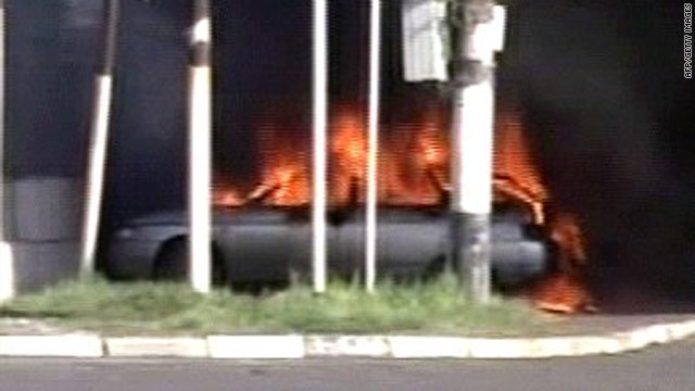 An image from Russian TV shows a burning car near a police station in Karabulak on April 5, 2010.