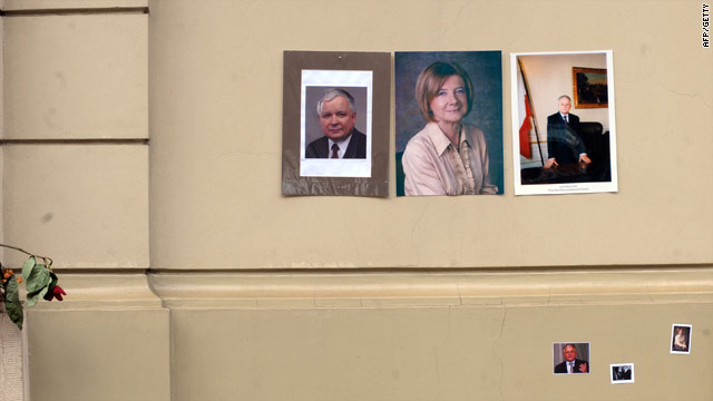Mourners placed pictures Monday April 12 of President Lech Kaczynski and his wife Maria outside their former Warsaw home.