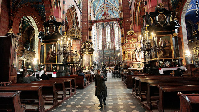 A woman exits St. Mary's Basilica in Krakow, Poland, on Saturday, a day before President Lech Kaczynski's funeral there.