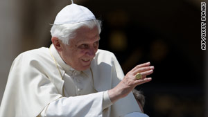 Pope Benedict XVI waves to pilgrims at St. Peter's Square at the Vatican at his weekly general audience Wednesday.