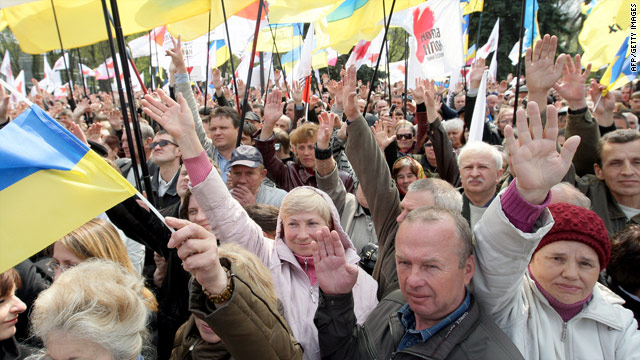 Opposition protesters wave hands at a mass meeting in front of the Ukrainian Parliament in Kiev on Saturday.